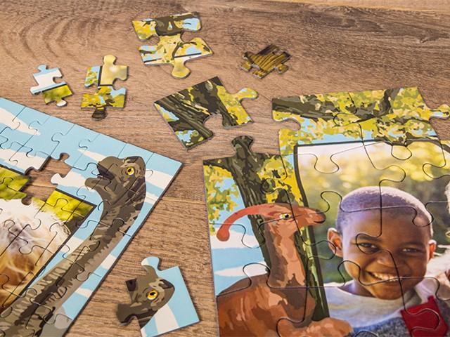 Größenvergleich der Puzzleteile vom Fotopuzzle mit 100 Teilen und Fotopuzzle mit 48 Teilen